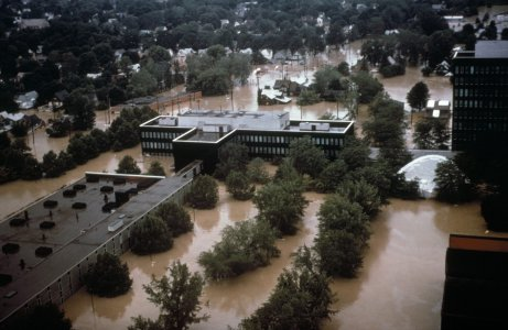 [Aerial view of B-building and parking lot during flood June 23, 1976] [slide].