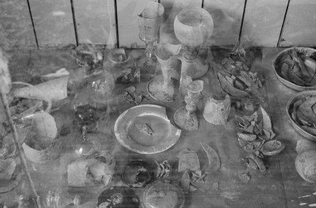 [Organizing fragments from flood-damaged glass objects] [picture].