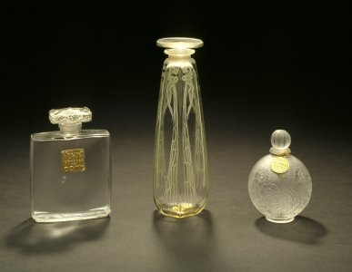 Muguet; cyclamen; small round perfume bottle with flowers [transparency]