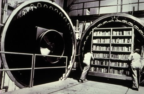 [General Electric vacuum chamber Valley Forge, PA, with frozen books on shelves inside chamber door] [slide].