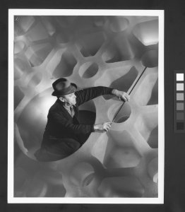 """[George Otis Gleason taking measurements of 200"""" disk while sitting inside center of disk] [picture]."""