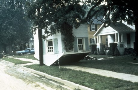 [Section of a home is left upside down when floodwaters recede] [slide].