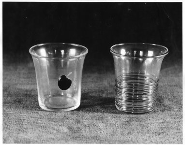 Shape no.: 1044 [photo of two cocktail glasses. One is crystal with red cherry and the other reeded] [picture].