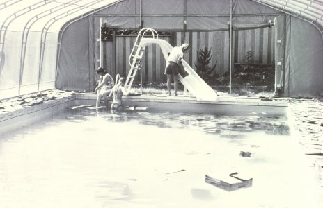 [Separation of flooded prints from mounts in Thomas S. Buechner's swimming pool] [slide].
