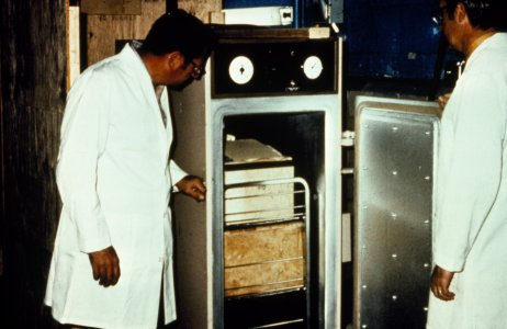 [Books are placed in the fumigation chamber to remove bacteria and mold] [slide].