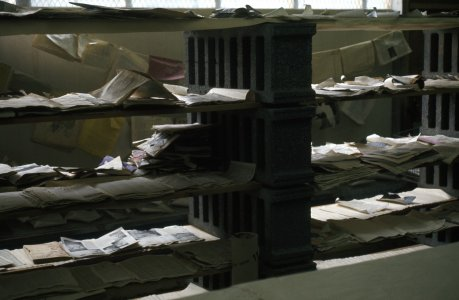 [Book pages drying on shelves in Acme building] [slide].