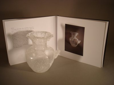Pitcher with faux exhibition catalog [picture].