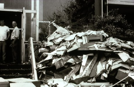 [Flood debris stacked outside museum entrance] [slide].