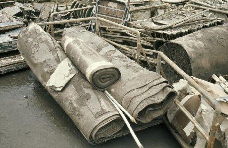 [Flood-damaged carpets] [slide].