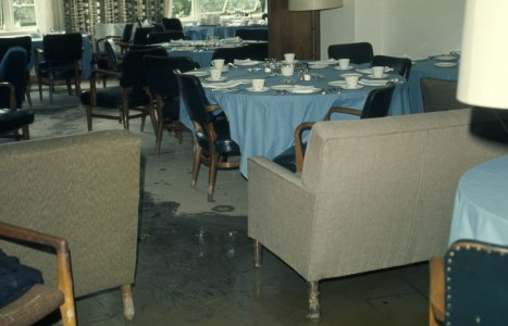 [Executive club dining area as floodwaters recede] [slide].