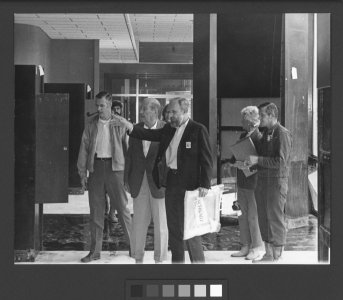 [Thomas Buechner with staff members and supporters in the museum galleries] [picture].