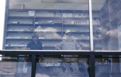 [Museum workers in office area] [slide].