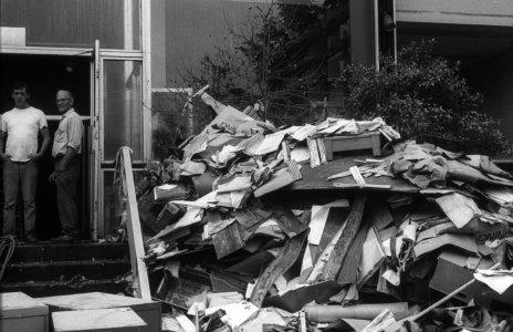 [Flood debris piled next to museum entrance] [slide].