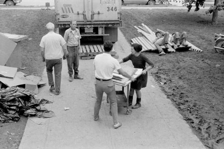 [Virginia Wright and library volunteers moving flood-damaged books to a truck] [picture].