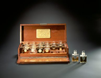 Fitted wooden box with various testers for Coty perfumes [transparency]