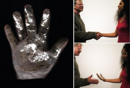 42 handshakes in two days/glass glove greetings [picture].