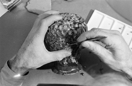 [A glass conservator repairing flood-damage ancient Roman ewer] [picture].