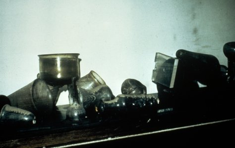 [Flood-damaged glass vessels in gallery case toppled and covered with mud] [slide].