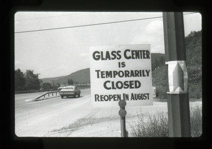 [Corning Glass Center road sign notifying tourists that the Museum is closed and will reopen again in August] [picture].
