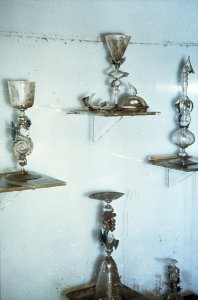 [Venetian glass vessels covered with flood mud] [slide].