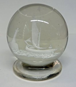 Paperweight with a Sailboat and Lighthouse