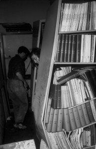 [Library shelves buckled into to V-shape] [slide].