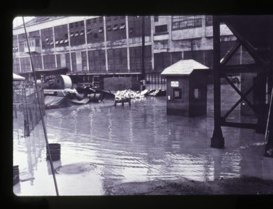 [Corning Glass Works factory surrounded by floodwater] [slide].