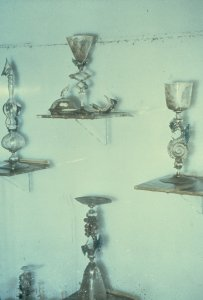[Gallery case with goblets and visible flood line] [slide].