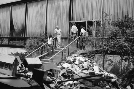[Museum workers stand next to pile of flood debris. 819649] [picture].