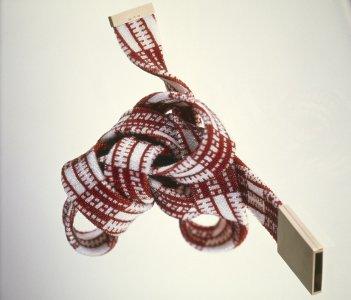Red and white neckpiece [slide].