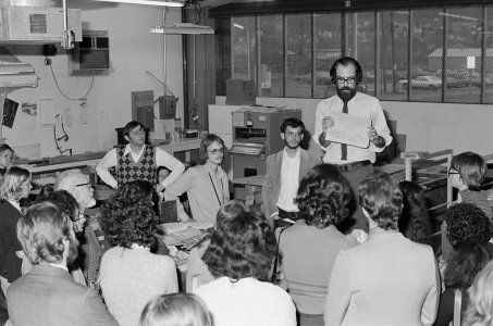 [Thomas Duncan instructing volunteers and students about paper conservation] [picture].