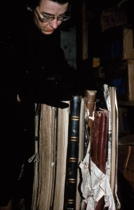 [Librarian Virginia Wright separating large frozen books] [slide].
