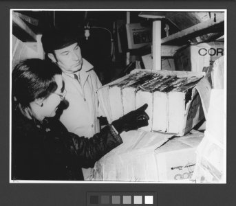 [Librarian Virginia Wright and Chemist David Fischer examine frozen books for mold growth] [slide].