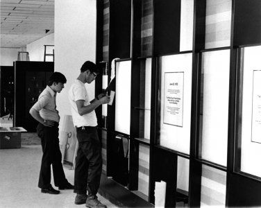 [Michael Moss and Raymond Errett affix labels before reopening day on August 1, 1972] [picture].