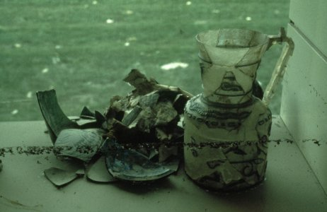 [Islamic glass vessels damaged by floodwaters] [slide].