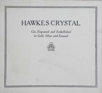Hawkes crystal: cut, engraved and embellished in gold, silver and enamel.