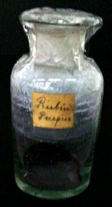 Specimen Bottle with Dark Purple Powder