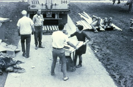[Librarian Virginia Wright and library volunteers moving flood-damaged books to a truck] [slide].