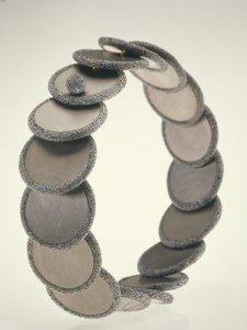 Disc neckpiece [slide].
