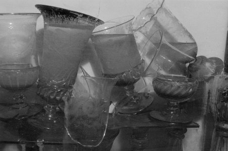 [Flood-damaged glassware broken and filled with floodwater] [picture].