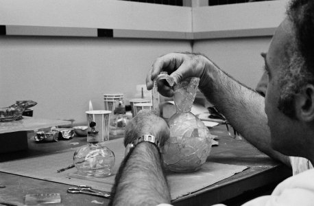 [Glass conservator Rolf Wihr restoring ancient Islamic pitcher] [picture].