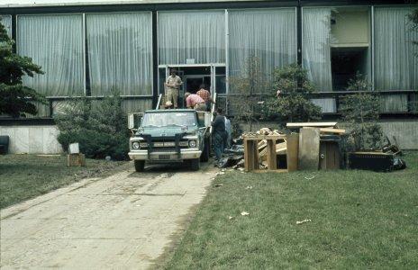 [Museum workers load flood debris onto truck] [slide].