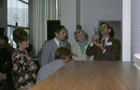 CMG Seminar 1977 [slide]: [group of people examing a beaker].