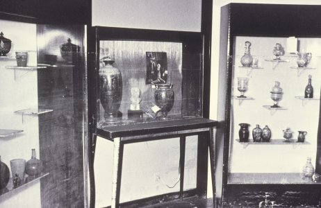 [Gallery cases and glass objects damaged by floodwaters] [slide].