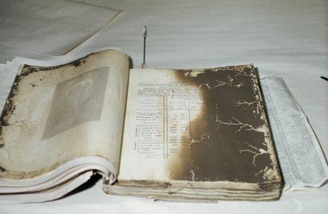 [Mud-damaged book] [slide].