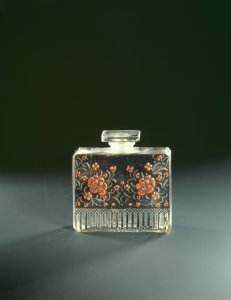 Perfume bottle with enameled orange flower blossoms for Raquel Meller [transparency]
