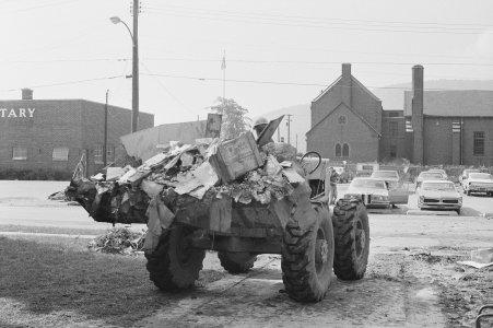 [Removing flood debris using heavy equipment] [picture].