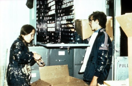 [Nina Perrot and Scott Martin organize flood-damaged slides before cleaning] [slide].