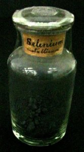 Specimen Bottle with Black Powder