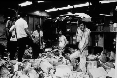 [Museum workers remove flood-damaged materials from storage area at Union Hall on Market St] [slide].